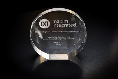 """Distribution Excellence Award"" presented to Silica Team by Maxim Integrated"
