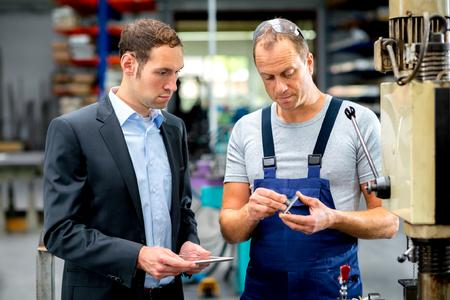 in the factory - (c) Firma V - Fotolia