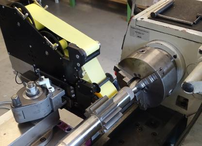 Thielenhaus Microfinish's attachments represent a cost-efficient opportunity to machine small batch sizes with finish tapes and stone tools using the base machines that you already own.