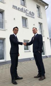 Mr. Takahiro Shimizu, TOYO Corporation, Japan and Benjamin Strube, mediCAD Hectec, Germany