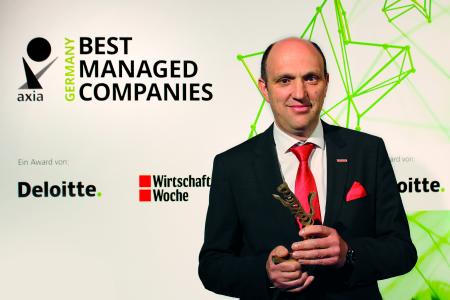 """Thomas Eschey with the """"Axia Best Managed Companies Award"""""""