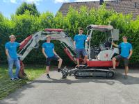 "Das Team von Sodex mit dem Prototyp des ""Software-Driven Excavator"" - (C) Sodex.at"