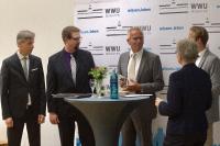 Ralph Weidling (Mitte) bei der Verleihung des Transferpreises 2018. Bildnachweis: Brigitte Heeke, AFO-WWU