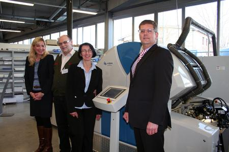 Happy faces at the printing centre of KBA-MePrint in Veitshöchheim: order received! Martina Mejzlikova, Regional Sales Director KBA-MePrint, Wieslaw Dziaduszek and wife, Management of Paper & Board with Holger Volpert, CEO KBA-MePrint AG (left to right).