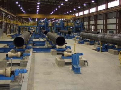 Links im Bild: Der Freiplatz für den vierten Nachschweißstand im Spiralrohrwerk der Stupp Corporation