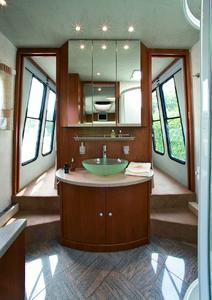 Left and right hand of the luxurious wash-stand opens smartish sliding doors the way to the easy entry queen-size bed.