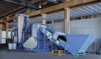 Herbold granulator recycling the production waste of one of the biggest of the big coextrusion blow-moulding machines in the world