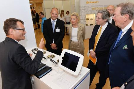 "Family shareholder Maria-Elisabeth Schaeffler-Thumann (center) and Chairman of the Supervisory Board, Georg F. W. Schaeffler (third from right) learned about new trends and developments during a tour of the event and were impressed by the broad range of exhibits at the ""Open Inspiration"" innovation fair at Schaeffler's premises in Herzogenaurach / Photo: Schaeffler"
