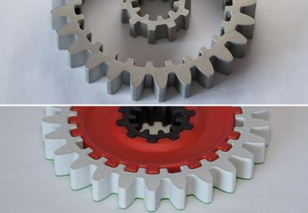 Abb4 METAKER modifiziertes Hybrid-Zahnrad in generativer Bauweise. Oben: SLM Bauteile nicht modifiziert, unten: modifiziert und mit PA 12 FDM (rot) verpresst.