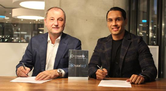 Concardis CEO Marcus W. Mosen (l) and Juan A. Sanmiguel (r), CEO of Hotelbird start their cooperation for mobile payment.