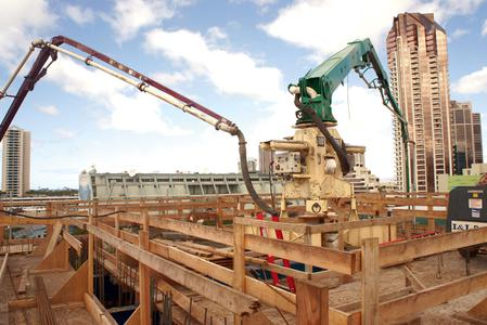 Different sized boom pumps from Ohana's fleet are utilized to place concrete in unusual situations for the high-rise tower.
