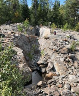 Photo 2 80m long trench on the Rivard Property, looking back along the strike of a gold-bearing vein