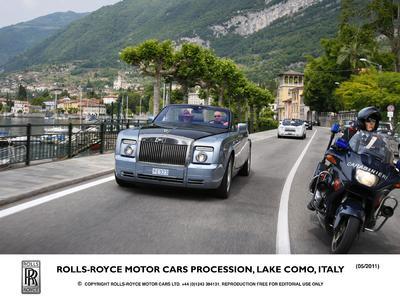 Italian Carabinieri support Rolls-Royce procession on Lake Como