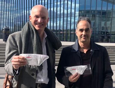 From left: Carlo Centonze, Dr. Thierry Pelet holding the first prototype of HeiQ Viroblock NPJ03 treated face masks (image provided by HeiQ)