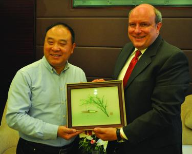 René Bucken, Head of Marketing and Senior Manager Sales at Schlafhorst with Mr. Wang Guogang, Chief Editor China Yarn
