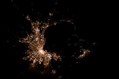 Tracking cities at night from the Space Station