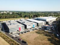 "The headquarters of the BMZ Group in Karlstein am Main, where currently a third production hall and the logistics center are being built (1st and 2nd buildings from the right). In future, the battery systems for the JV will be produced in ""Unit 3"""