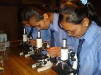 "Handling a microscope is also part of medical training at the ""Bhaktapur Homeopathic Clinic and Medical College"". Image: Bhaktapur Homeopathic Clinic and Medical College"
