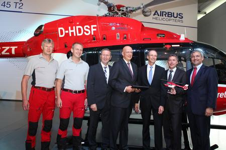 From left to right: Johann Haslberger (Pilot DRF Luftrettung), Franz Ahollinger (Pilot DRF Luftrettung), Manfred Merk (Head of EC145 Program), Dr. Hans Jörg Eyrich (Executive Board DRF Luftrettung), Dr. Wolfgang Schoder (CEO Airbus Helicopters Germany), Steffen Lutz (Executive Board DRF Luftrettung) and Thomas Hein (Vice President Customer Relations and Sales Europe for Airbus Helicopters) (© Copyright Airbus Helicopters)