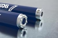 Servo couplings for bridging larger distances without an intermediate bearing support
