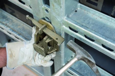 Fastening the swivel bearing that holds the tapering tie rod end on a NOEtop large area panel.
