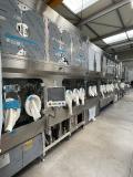 Quelle: ROTA Verpackungstechnik GmbH & Co.KG: Anlage zum Waschen, Sterilisieren, Füllen, Verschließen und Außenwaschen unter Isolator.