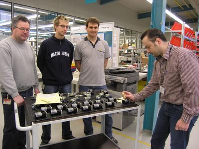 A satisfied assembly team completes the final acceptance of the 1000th flight lock actuator at the WITTENSTEIN aerospace&simulation assembly shop in Igersheim-Harthausen (from right to left): Team Manager Stefan Zang with Daniel Landwehr, Marcus Michel an