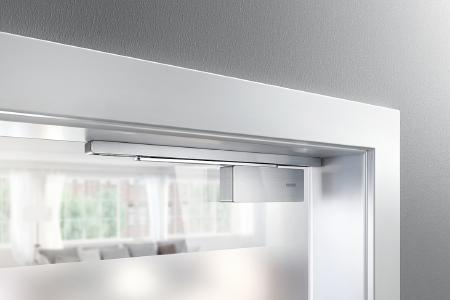 GEZE ActiveStop door damper fitted on the door frame / Photos:  GEZE GmbH