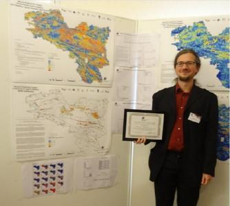 "Andreas Brosig from Beak Consultants GmbH with award for ""2017 Mineral Prospectivity Contest"""