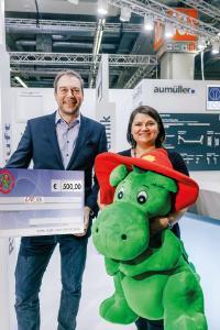Grisu sammelt Spenden bei Aumüller Aumatic