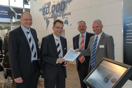 Handing over of Statement of Compliance at Hannover Fair (f.l.t.r. Zundel,...
