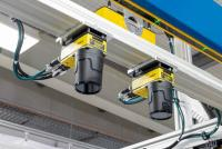 In-Sight vision systems measure the parts and the board and guide the gripper
