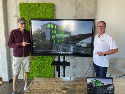 Das Foto zeigt: Martin Häusler (links), Haeusler Arts Studios, und Matthias Blatz, Geschäftsführer Heidelberg iT Management GmbH & Co. KG, beim Launch des neuen 3D-Imagetrailers der Heidelberg iT. Foto: Heidelberg iT