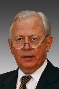 Dr. Jaques Santer