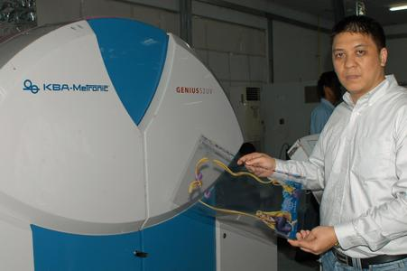 PT Printec has made significant achievements in quality and production efficiency since the two Genius 52UV machines started production. The picture shows Sansico Director Rudy Ghozali with a sample of printing on high-quality plastic packaging