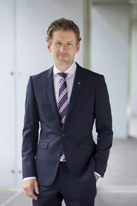 Dr. Andreas Hauser