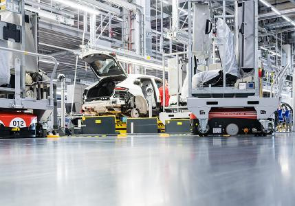 Grenzebach L1200S AGVs deliver seats just-in-sequence and with high precision for the assembly into the corresponding sports cars. Credit: Porsche Leipzig GmbH
