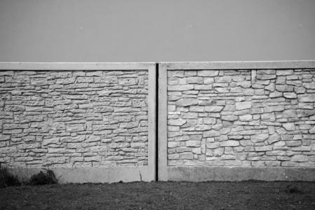 Can you tell the difference between concrete and real stone in this black and white photograph?