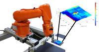 Automatisierte Wirbelstromprüfung eines Faserverbundkunststoffs mit innenliegender Delamination, die im Prüfergebnis farblich kodiert visualisiert werden konnte (Ausschnitt vergrößert)