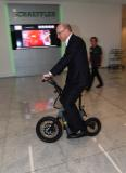 Prof. Dr.-Ing. Tim Hosenfeldt, Senior Vice President Technology Strategy & Innovation at Schaeffler AG, tests one of the business ideas presented, the Steereon electric scooter from PLEV Technologies GmbH (Photo: Schaeffler)
