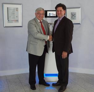 Dr. Karl Spanner (left) managing director of PI (Physik Instrumente) with and Lucius Amelung, managing director of PI-miCos