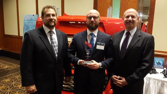 "Automotive division of Jenoptik received the ""SPE Automotive Innovation Award"" in Livonia, Michigan. In this way, the Society of Plastic Engineers rewards Jenoptik's excellent machine concepts. The picture shows Steve Janson, Torsten Reichl and Bob Aiello (from left) at the awards ceremony / Source: Jenoptik"