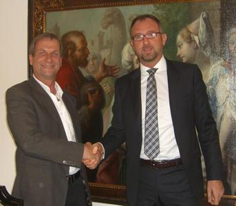 Jean-Pierre Heinrichs (CEO NET GmbH) in agreement with Vincenzo Bava (CEO NET Italia S.r.l.)