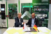 Junji Yamada (Fuji Industries) and Felix Michl (Cevotec) sign the representation and reseller agreement