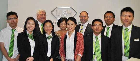 On October 24th 2013 in Shanghai during the occasion of the Dentech International Exhibition, Peter Malata, President of the W&H Group, opened the new W&H China offices in Shanghai. From left to right: Zhou Jun (Technical), Rita Chen (Sales), Peter Dorrell (General Manager), May Zhang (Sales), Lily Chen (Assistant), Fiona Tian (Office Admin), Peter Malata, President of the W&H Group, Jerry XiaBo (Sales), Xunge Yin (Sales) and Lin Yu (Sales)