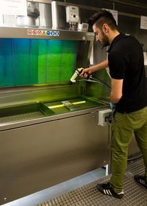 The precision parts and high-tech components are wetted with a fluorescent penetrant for the testing