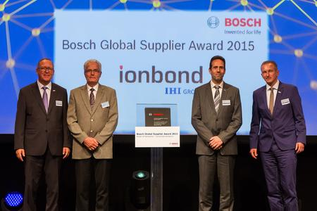 Boudewijn Buil and André Hieke (2nd and 3rd from left) of Ionbond's Automotive Competence Center in Venlo, NL at the award ceremony with Dr. Karl Novak and Dr. Norbert Neumann of Bosch (left and right)