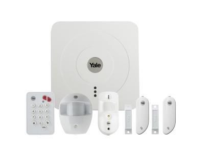 Das Smart Home Alarmset SR-3200i von Yale umfasst außer dem zentralen Smart Hub bereits Tür- und Fensterkontakte sowie Bewegungsmelder mit und ohne Kamera. Foto: ASSA ABLOY Sicherheitstechnik GmbH