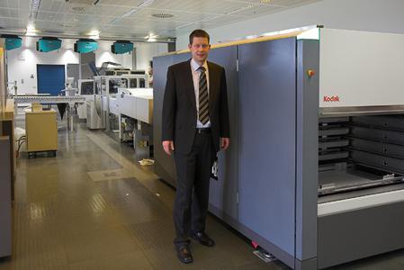 Erik Hofmann, stellvertretender Technischer Leiter der Freien Presse Chemnitz, am ersten von insgesamt vier KODAK GENERATION NEWS Systemen