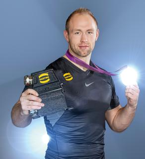 Discus thrower Robert Harting at the HARTING trade fair stand on November 26, 2013